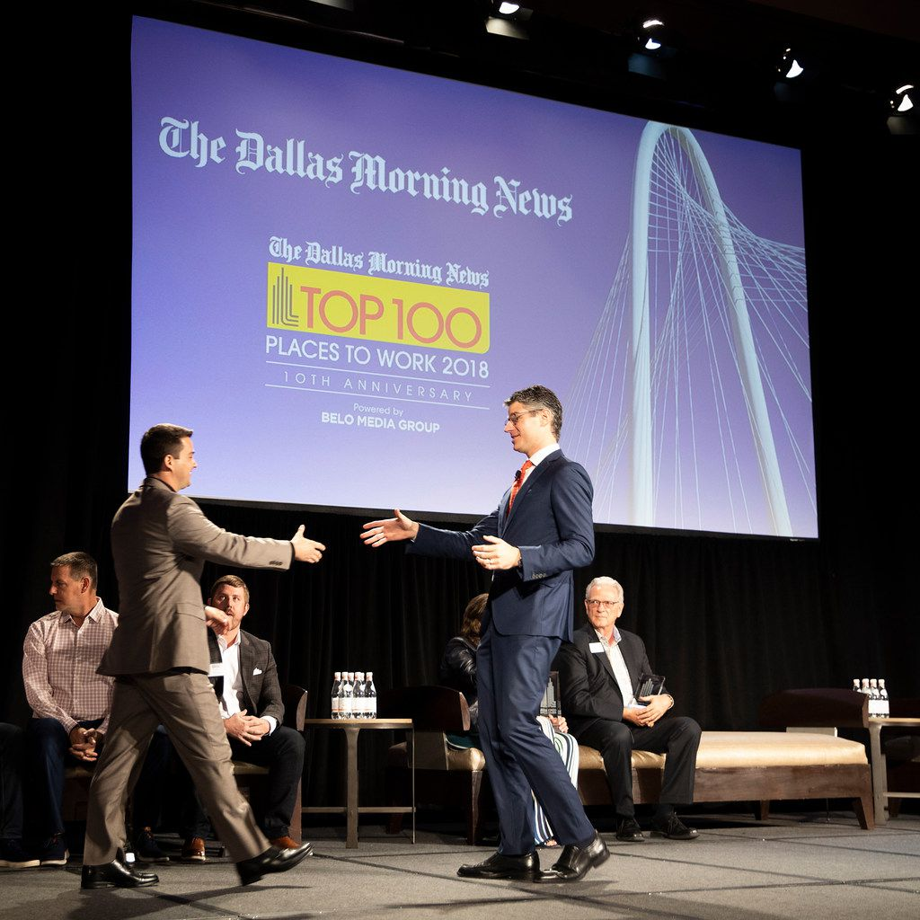 Grant Moise (right), president and publisher of The Dallas Morning News, shook hands with Josh Harley, CEO of Fathom Realty, the No. 1 large company, during the 2018 Dallas Morning News Top 100 luncheon at the Omni Dallas Hotel.
