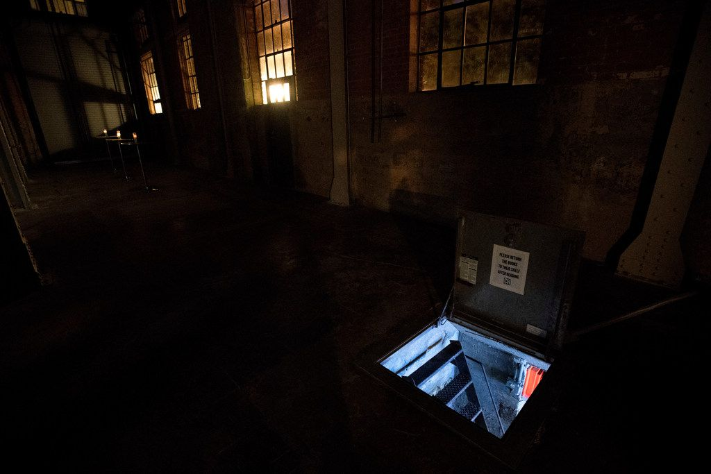 Light emanates from Culture Hole, a 44-square-foot underground art exhibition space with a 3.5-foot ceiling located within The Power Station art gallery