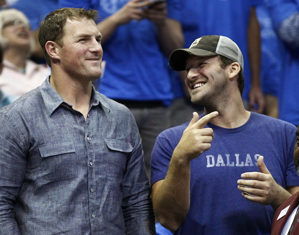 Dallas Cowboys Jason Witten, left, and Tony Romo watched the Dallas Mavericks and San Antonio Spurs play from behind the Mavs bench during the first half of the NBA Western Conference Quarterfinals Game 4 at the American Airlines Center in Dallas, Monday, April 28, 2014. (Tom Fox/The Dallas Morning News)