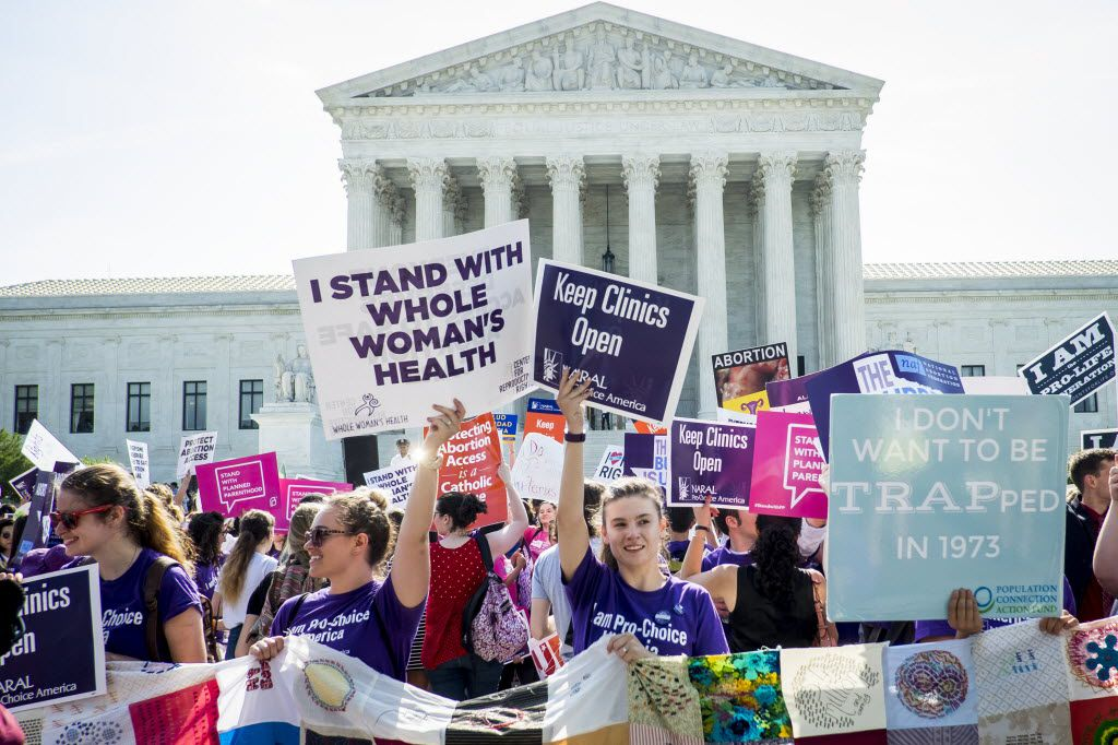 Demonstrators for and against abortion rights crowded the steps of the U.S. Supreme Court on Monday in Washington, D.C. In a 5-3 decision, the court struck down one of the nation's toughest restrictions on abortion, a Texas law that women's groups said would have forced more than three-quarters of the state's clinics to close.