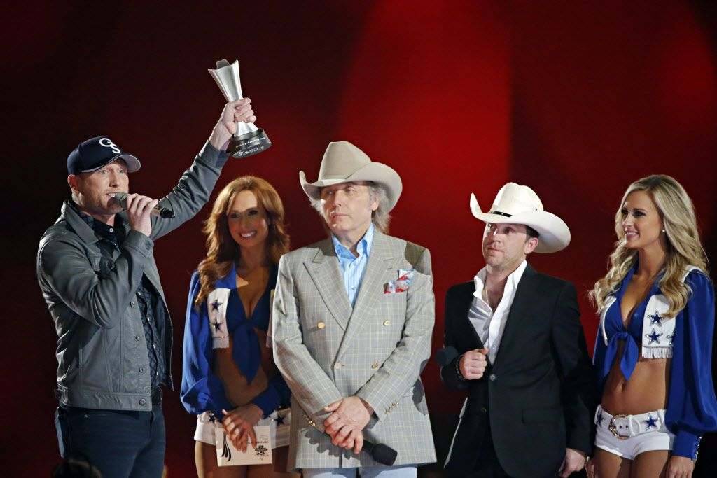 Cole Swindell (left) holds his New Artist of the Year award in the air during the 2015 Academy of Country Music Awards Sunday, April 19, 2015 at AT&T Stadium in Arlington, Texas.