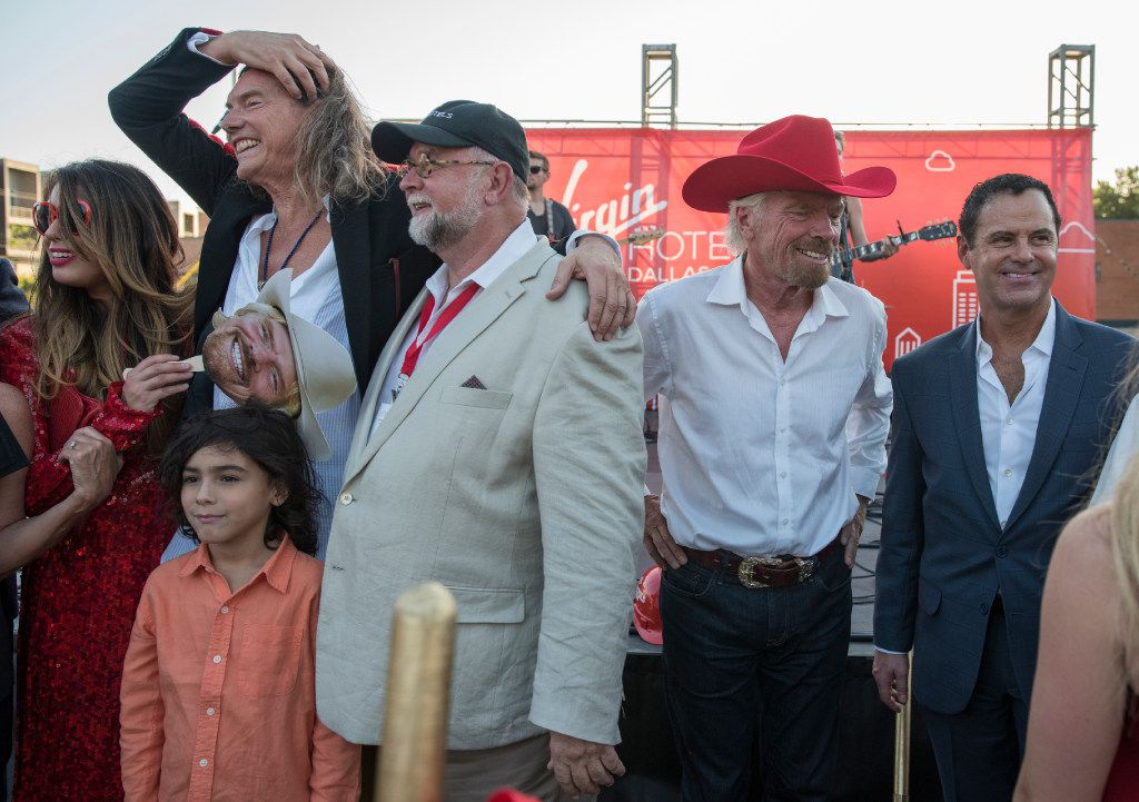 From left:  Bill Hutchinson (Founder and President of Dunhill Partners), Marty Collin (CEO of Gatehouse Capital), Richard Branson, and Raul Leal (CEO of Vrigin Hotels) gather after the ground breaking for a new hotel in the Design District on Monday, Oct. 17, 2016.   (Rex C. Curry/Special Contributor)