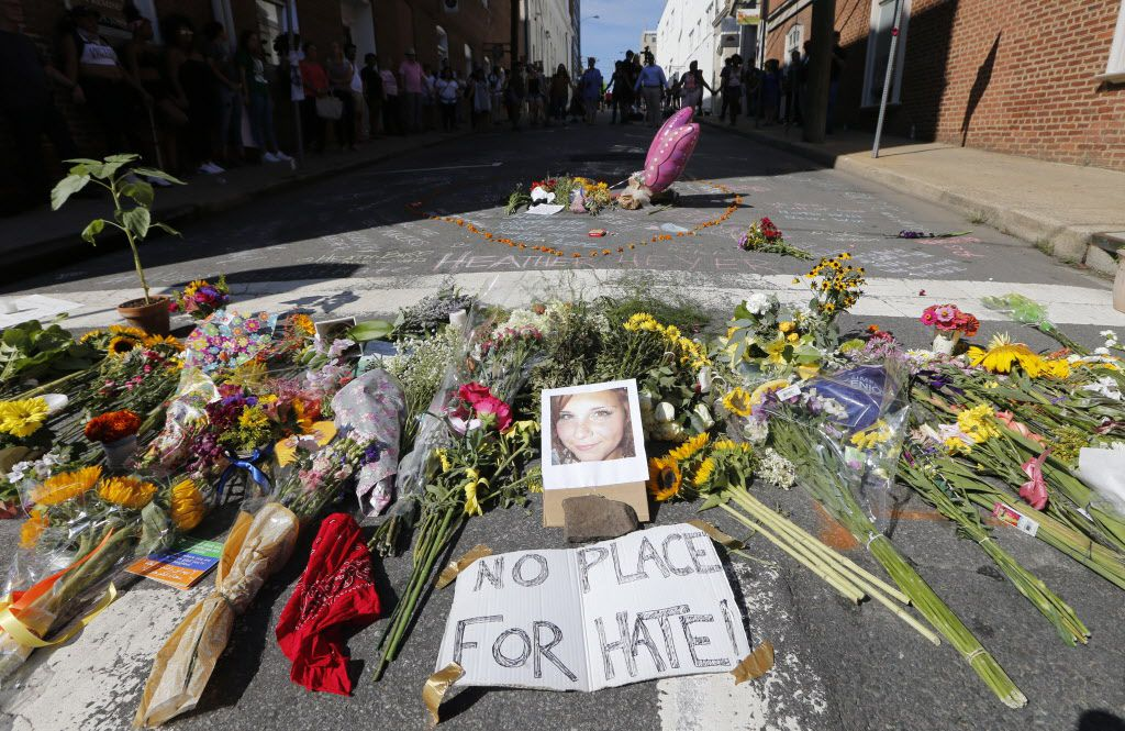 A makeshift memorial of flowers and a photo of victim, Heather Heyer, sits in Charlottesville, Va., Sunday, Aug. 13, 2017. Heyer died when a car rammed into a group of people who were protesting the presence of white supremacists who had gathered in the city for a rally.