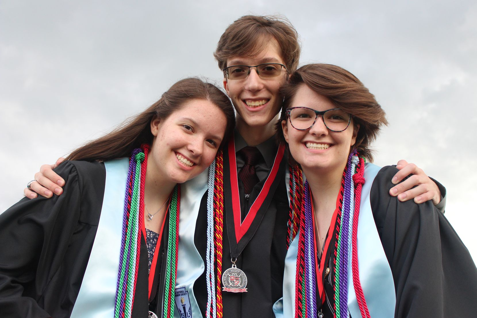 Triplets Jackie, Ian and Kelsey Carroll graduated from Lovejoy High School in May. Jackie and Kelsey had to make up their AP Physics C: Electricity and Magnetism exam two days after receiving their high school diploma. All three of the siblings graduated in the top 10% of their class, which was something they wanted to achieve together. Kelsey said taking as many AP classes as she could help raise her GPA to the top of the class.