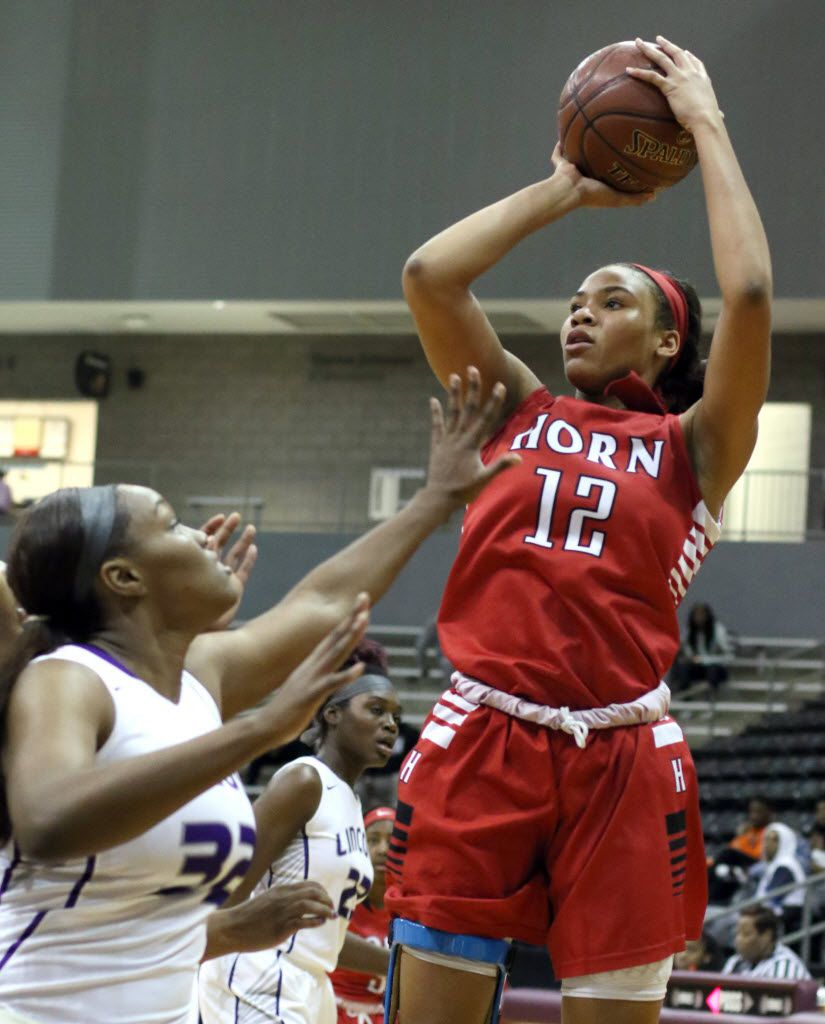 Mesquite Horn guard Jada Underwood (12) gets off a jump shot over the defense of Dallas Lincoln post Jalah Walton (32) during first half action. The two teams played their day two tournament game in the annual DISD/Coca-Cola basketball tournament held at Ellis Davis Field House in Dallas on December 29, 2015. (Steve Hamm/Special Contributor)