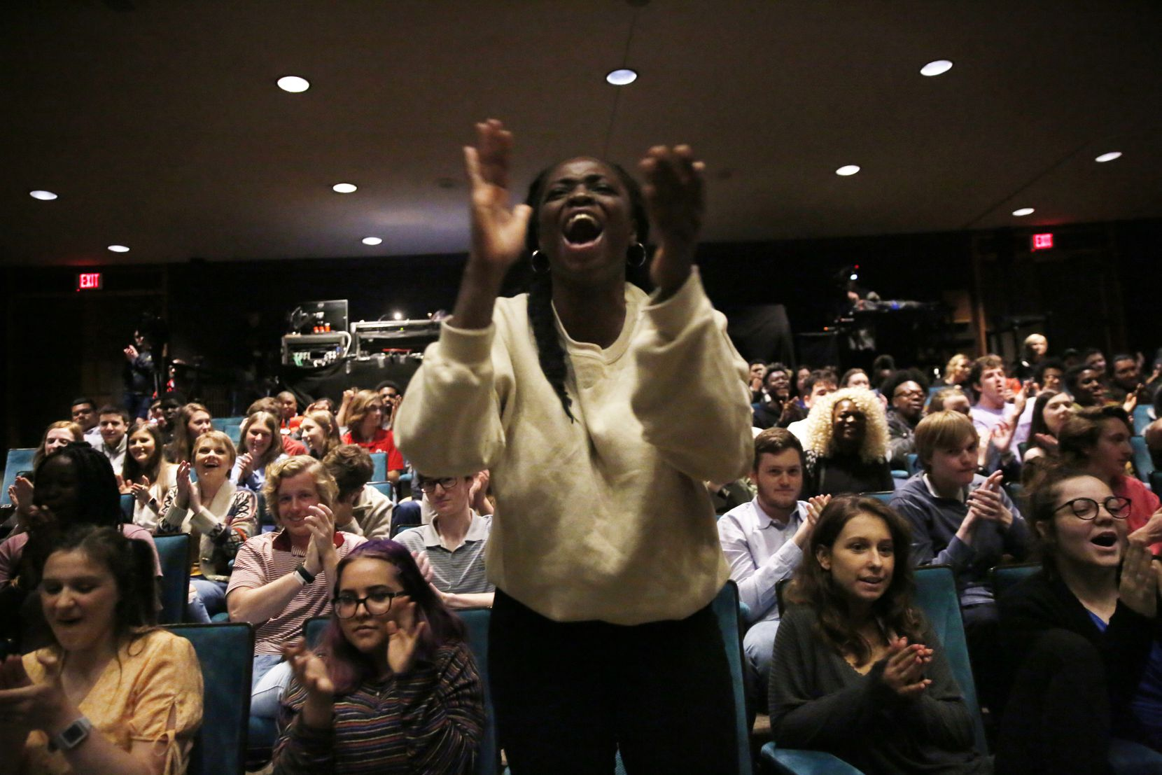 Mary Ukiri, a junior at Lake Highlands High School, cheers for her classmate as he performs during a Hamilton Education Program event at the Music Hall at Fair Park in Dallas on Thursday, May 2, 2019.