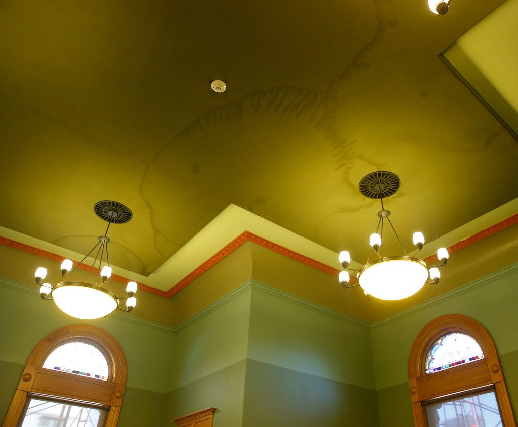 Water has seeped through the ceiling of the Hatton W. Sumners Court Room in the Old Red Courthouse.