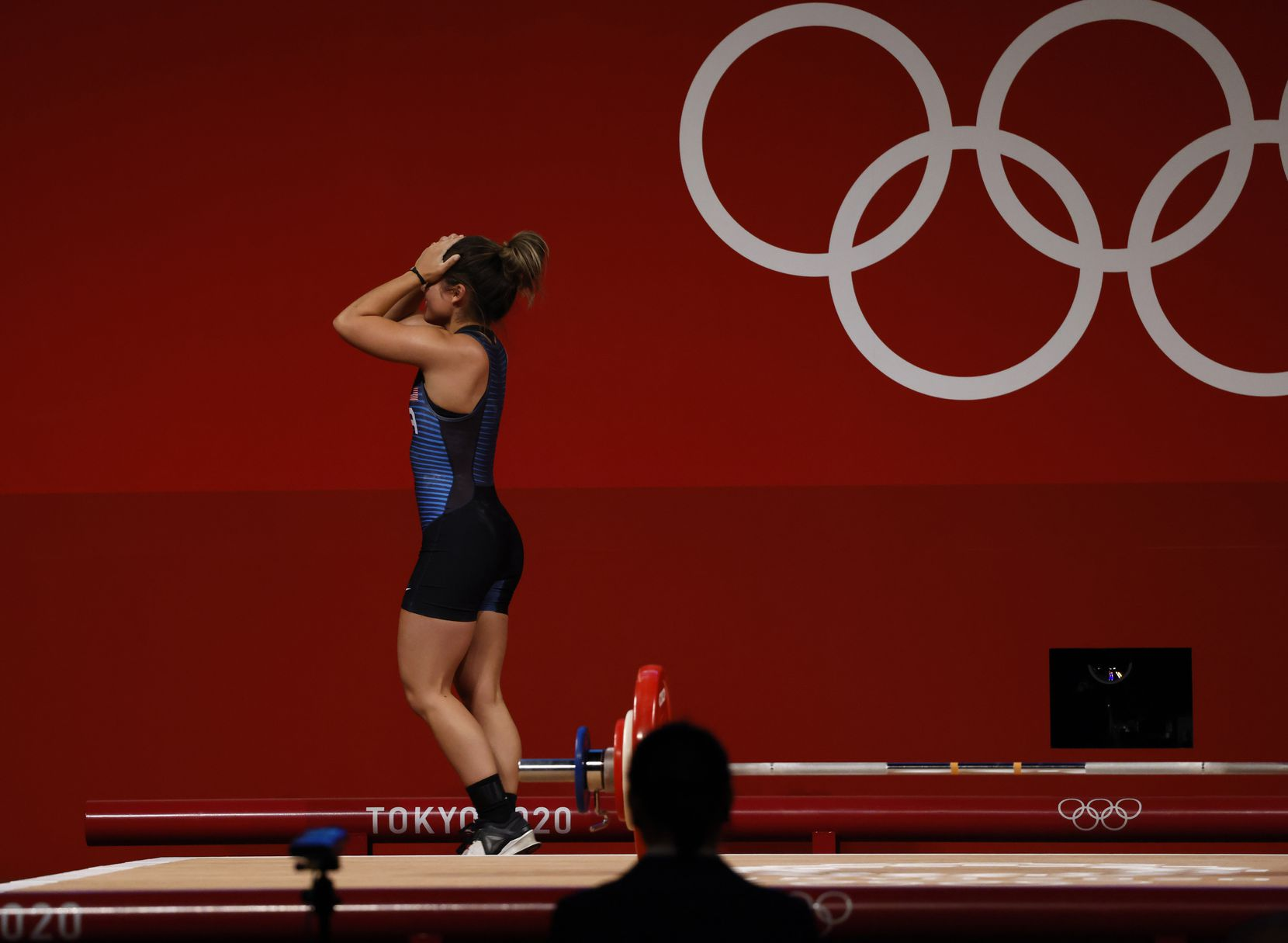 USA's Jourdan Delacruz after attempting to lift 89kg on her third attempt of the snatch round during the women's 49 kg weightlifting final  during the postponed 2020 Tokyo Olympics at Tokyo International Forum on Saturday, July 24, 2021, in Tokyo, Japan. Delacruz received a no-lift from the judges on this lift. (Vernon Bryant/The Dallas Morning News)