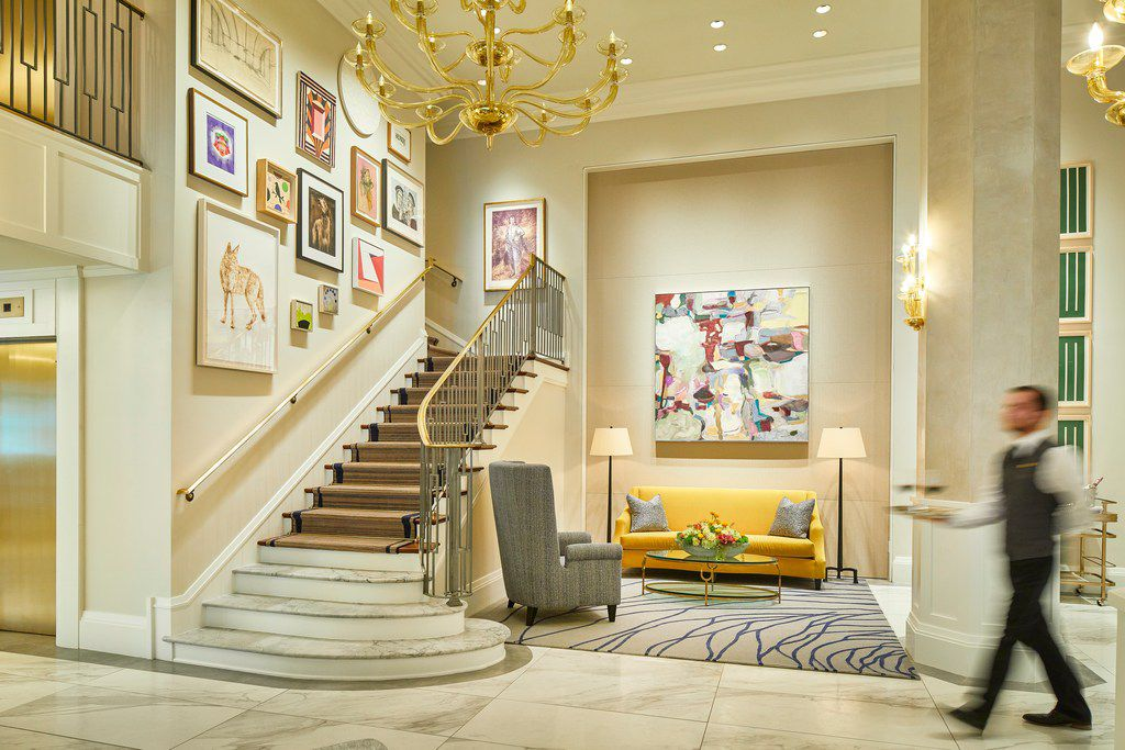 The redesigned Lancaster Hotel lobby facing the Salon Staircase, which showcases many of the hotel's more than 200 contemporary paintings by Texas authors.
