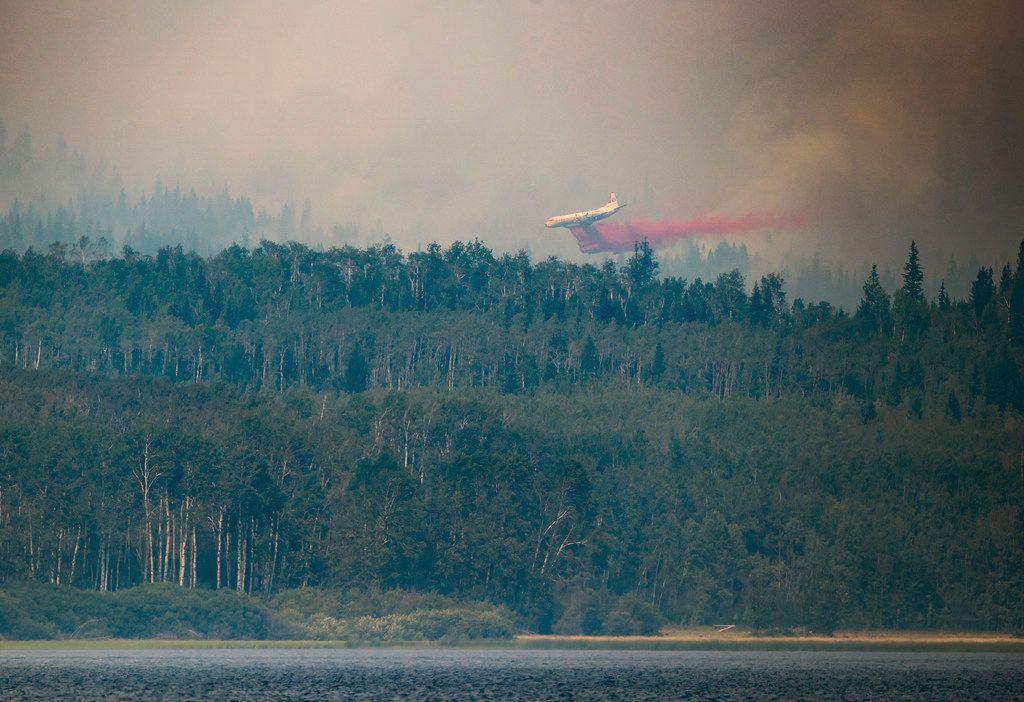 A tanker drops retardant while battling the Shovel Lake wildfire near Fraser Lake, British Columbia, on Friday.