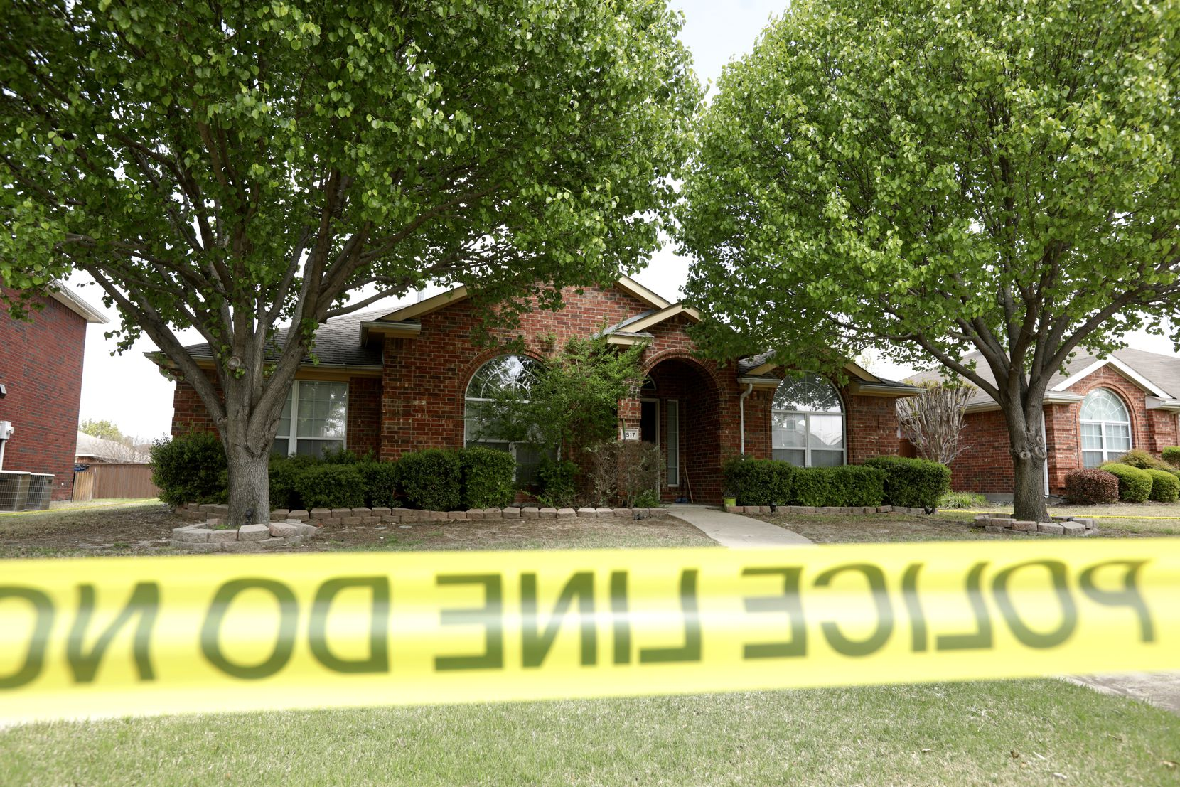 Police tape surrounded the family's home Monday.