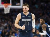 Dallas Mavericks guard Luka Doncic (77) smiles during the first quarter of an NBA game between the Indiana Pacers and the Dallas Mavericks on Sunday, March 8, 2020 at American Airlines Center in Dallas.