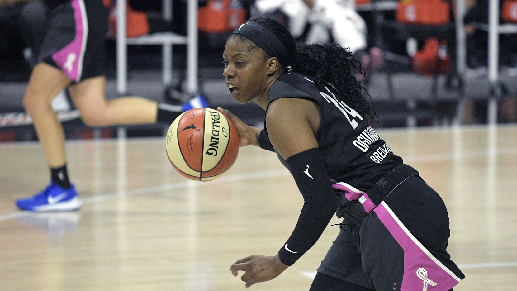 Dallas Wings guard Arike Ogunbowale (24) pushes the ball up the court during the first half of a WNBA basketball game against the Las Vegas Aces, Tuesday, Aug. 25, 2020, in Bradenton, Fla.