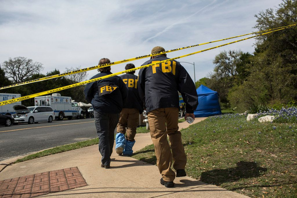 FBI agents at the scene of Sunday's explosion that injured two people in southwest Austin, March 19, 2018. A fourth bomb triggered by a tripwire suggests a higher level of sophistication in the wave of bomb attacks that have unnerved the residents of Austin. (Tamir Kalifa/The New York Times)