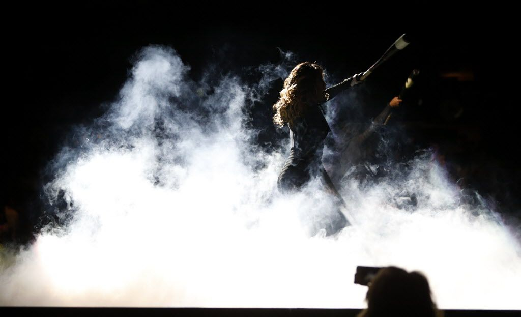 A dancer performs as musical artist Nelly makes his way to the stage during a performance at American Airlines Center in Dallas, on Thursday, May 14, 2015.