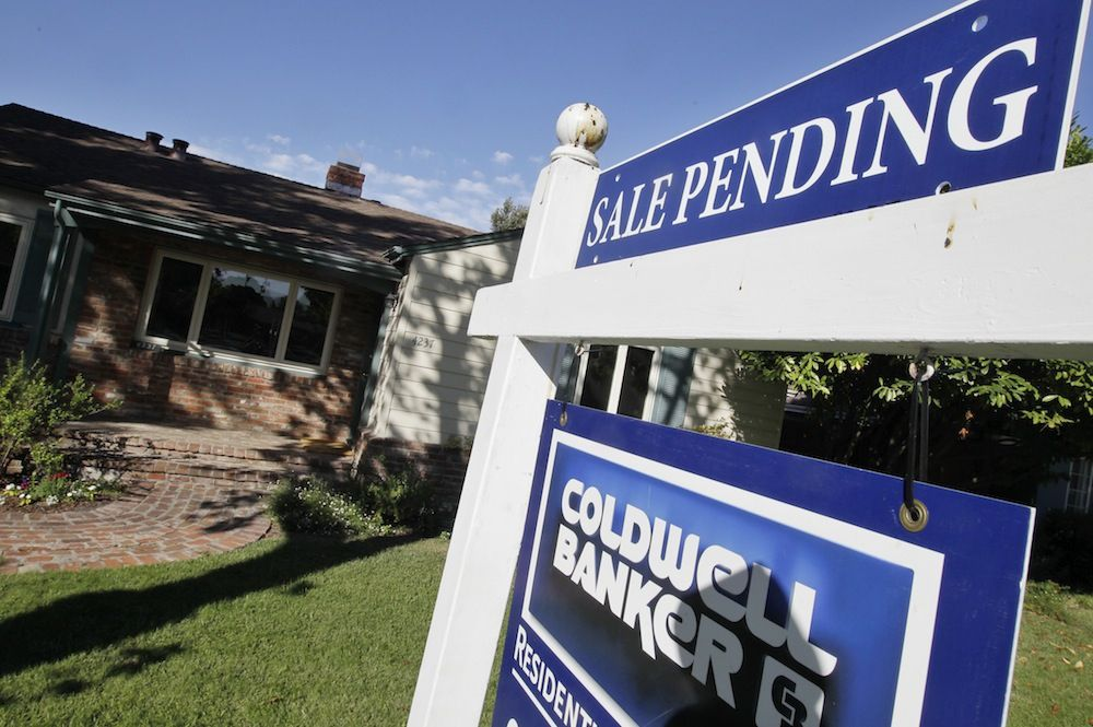 This Tuesday, Aug. 21, 2012, photo, shows an exterior view of house with a pending home sale sign in Palo Alto, Calif. Americans signed the most contracts to buy homes in July than at any other point in the last two years, further evidence of a housing recovery. (AP Photo/Paul Sakuma) 08302012xBIZ