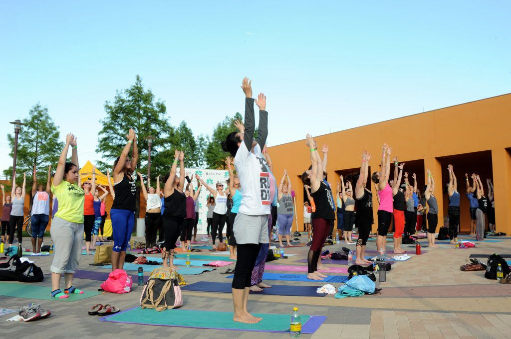 Yogis practice the upward salute at the D-FW Free Day of Yoga Kickoff at the Latino Cultural Center in Dallas, TX on September 3, 2016. (Alexandra Olivia/ Special Contributor)