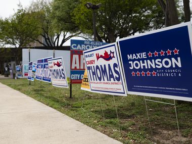 Campaign signs for Dallas City Council candidates\ fill the grass areas outside of the Oak Cliff Sub-Courthouse on the first day of early voting in Dallas, on Monday, April 19, 2021