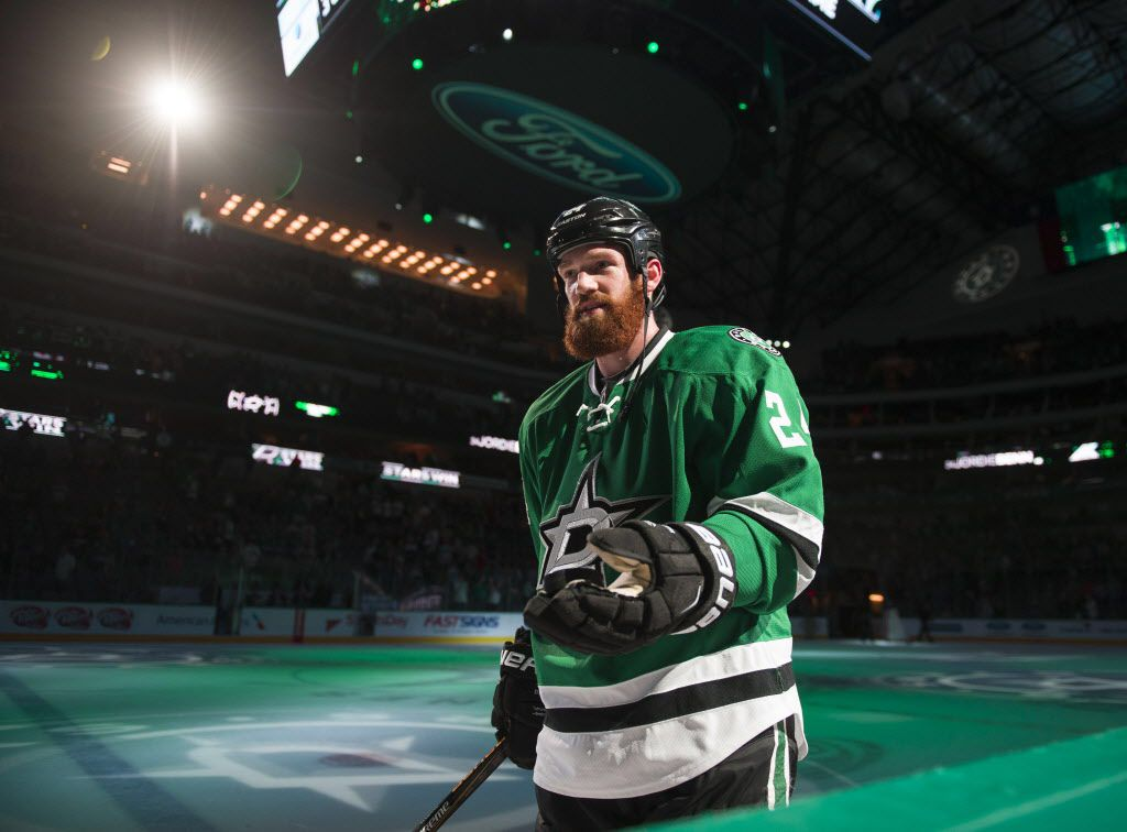 Apr 7, 2016; Dallas, TX, USA; Dallas Stars defenseman Jordie Benn (24) throws a puck into the stands after the game against the Colorado Avalanche at the American Airlines Center. The Stars won 4-2. Mandatory Credit: Jerome Miron-USA TODAY Sports