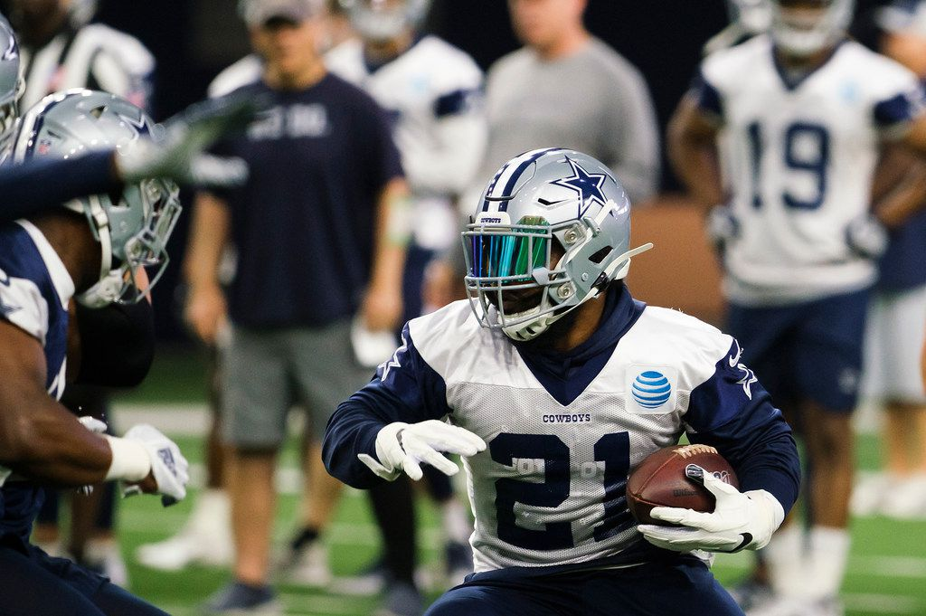 Dallas Cowboys running back Ezekiel Elliott (21) runs the ball during a team OTA practice at The Star on Wednesday, June 5, 2019, in Frisco. (Smiley N. Pool/The Dallas Morning News)