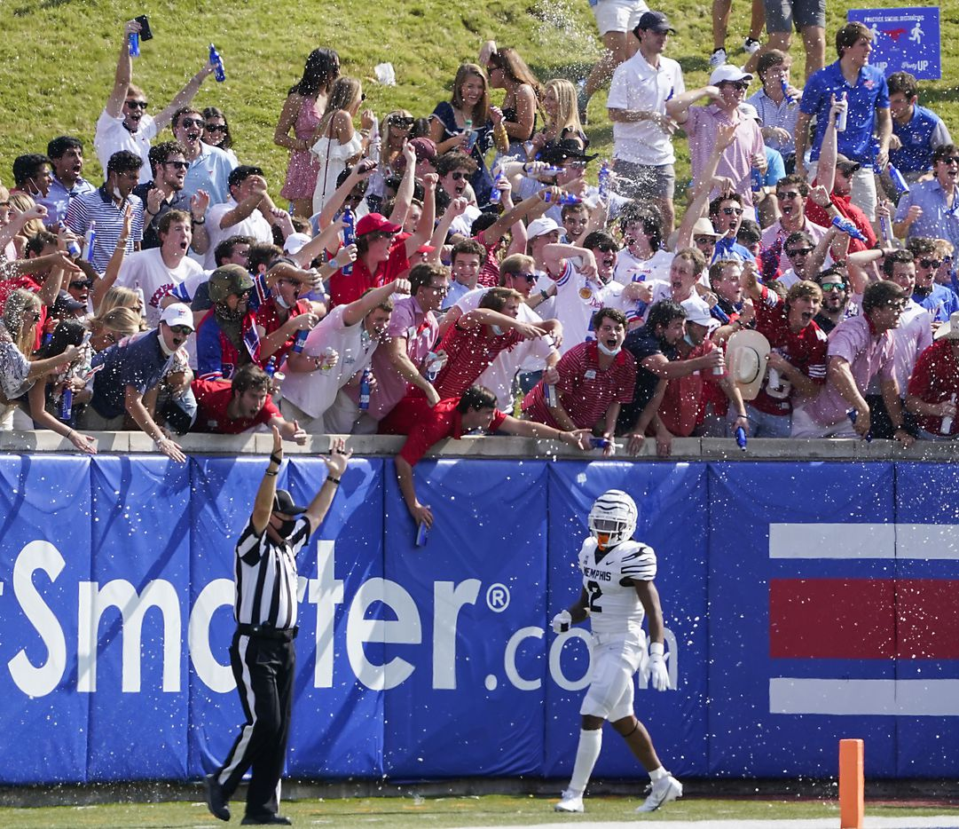 SMU fans in the student section on the hill cheer after a touchdown by wide receiver Reggie Roberson Jr. as Memphis defensive back T.J. Carter (2) turns away during the first half of an NCAA football game at Ford Stadium on Saturday, Oct. 3, 2020, in Dallas.