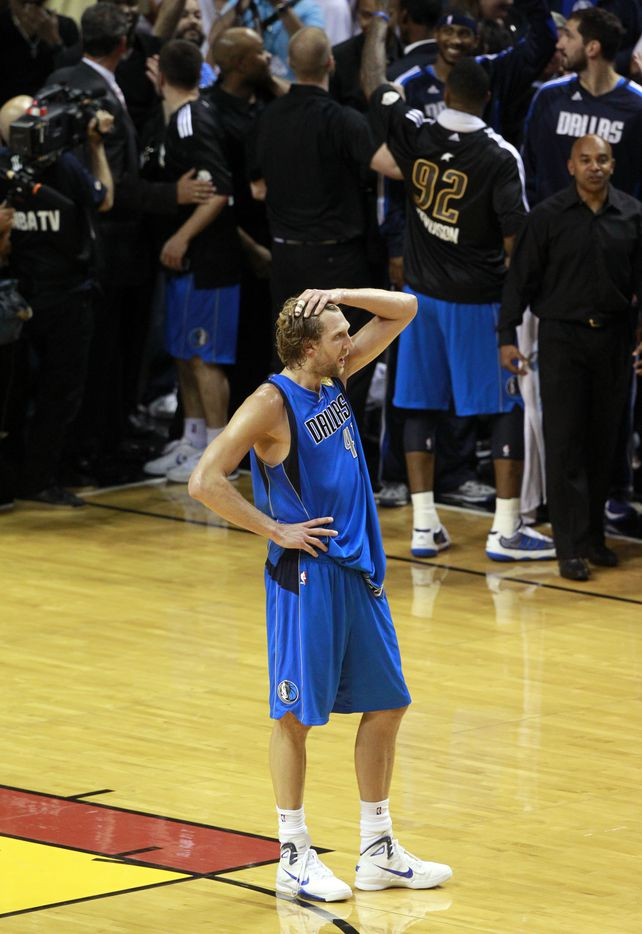 Dallas Mavericks power forward Dirk Nowitzki (41) stands alone after winning game six of the NBA Finals between the Miami Heat and the Dallas Mavericks at the American Airlines Arena in Miami, Florida, June 12, 2011. Mavs win 105 - 95 (Michael Ainsworth/The Dallas Morning News)