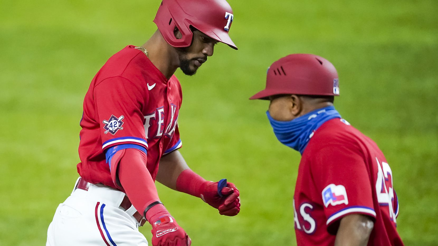 Texas Rangers center fielder Leody Taveras gets a hand from third base coach Tony Beasley as he rounds the bases after hitting solo home run during the third inning against the Los Angeles Dodgers at Globe Life Field on Saturday, Aug. 29, 2020.
