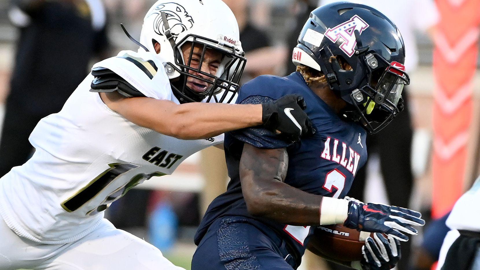 Plano East's Holden Stokes tackles Allen's Jaylen Jenkins (2) in the first half during a high school football game between Plano East and Allen, Friday, Aug. 27, 2021, in Allen, Texas.