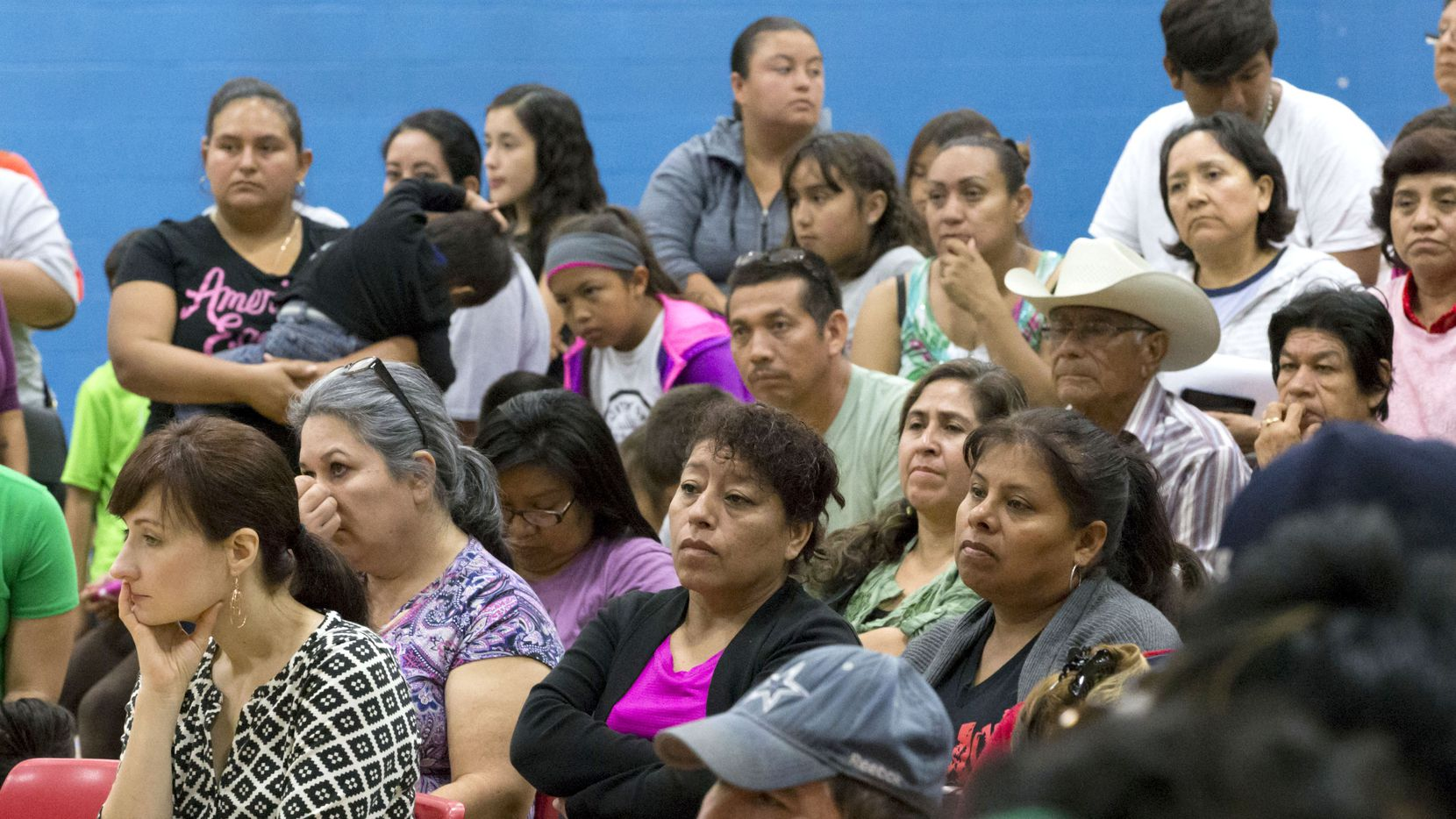 Community members listen to announcements during a community meeting regarding upcoming mass evictions in West Dallas by landlord HMK Ltd at Anita Martinez Recreation Center on Oct. 8, 2016 in Dallas.