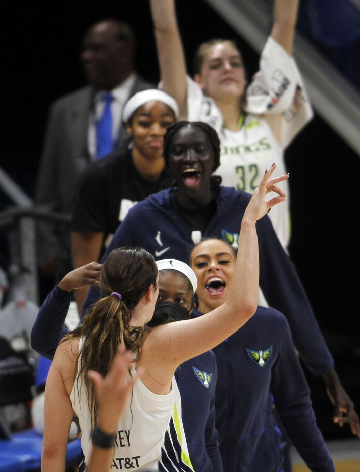 Dallas Wings guard Marina Mabrey (3, back to camera) gestures after sinking a 3-pointer and igniting the Wings bench in the waning seconds of the first half against the Chicago Sky. The two WNBA teams played their game at College Park Center in Arlington on July 2, 2021. (Steve Hamm/ Special Contributor)