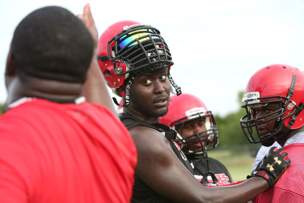 Cedar Hill Longhorns defensive lineman Shabazz Dotson was all ears (and eyes) as he takes in the instruction of defensive line coach Ray Gates during a drill. The Longhorns hit the field for their season opening practice session under the direction of their new head coach Carlos Lynn at Cedar Hill High School in Cedar Hill on August 14, 2017. (Steve Hamm/Special Contributor)