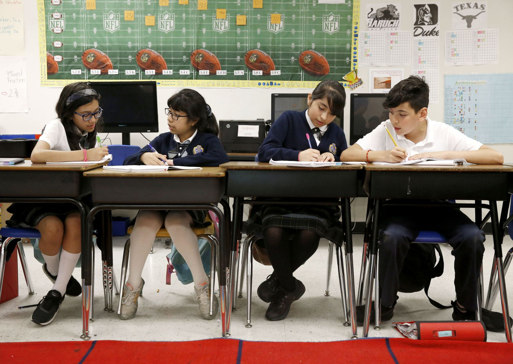 Daniela Hernandez, (from left) Beatriz Ramirez, Briana Morales and Juan Pablo Ortiz work on math problems during class at Annie Webb Blanton Elementary in Dallas on May 17, 2018.