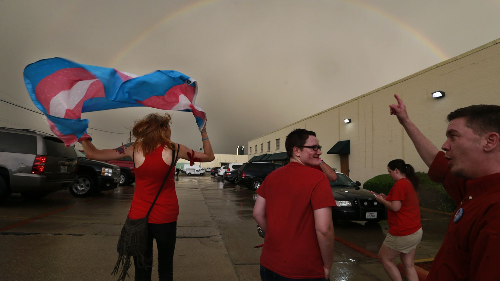 After a Fort Worth school district meeting earlier this year at which transgender policies in schools was discussed, a full rainbow appeared over the Fort Worth ISD complex. Leaving the meeting with flag over her head was Alison Francis of Hurst.