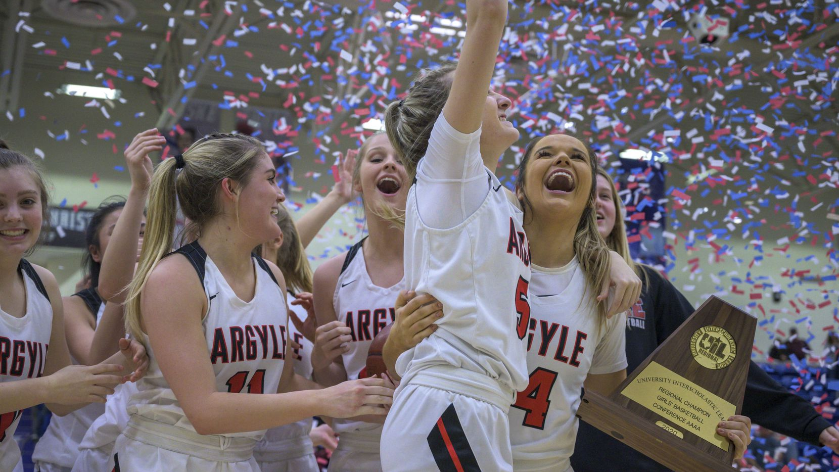 Guard Abby WIlliams celebrates with Rhylie McKinney after winning the Class 4A Region 1 championship, Feb. 29, 2020. Argyle defeated Bridgeport, 42-38.