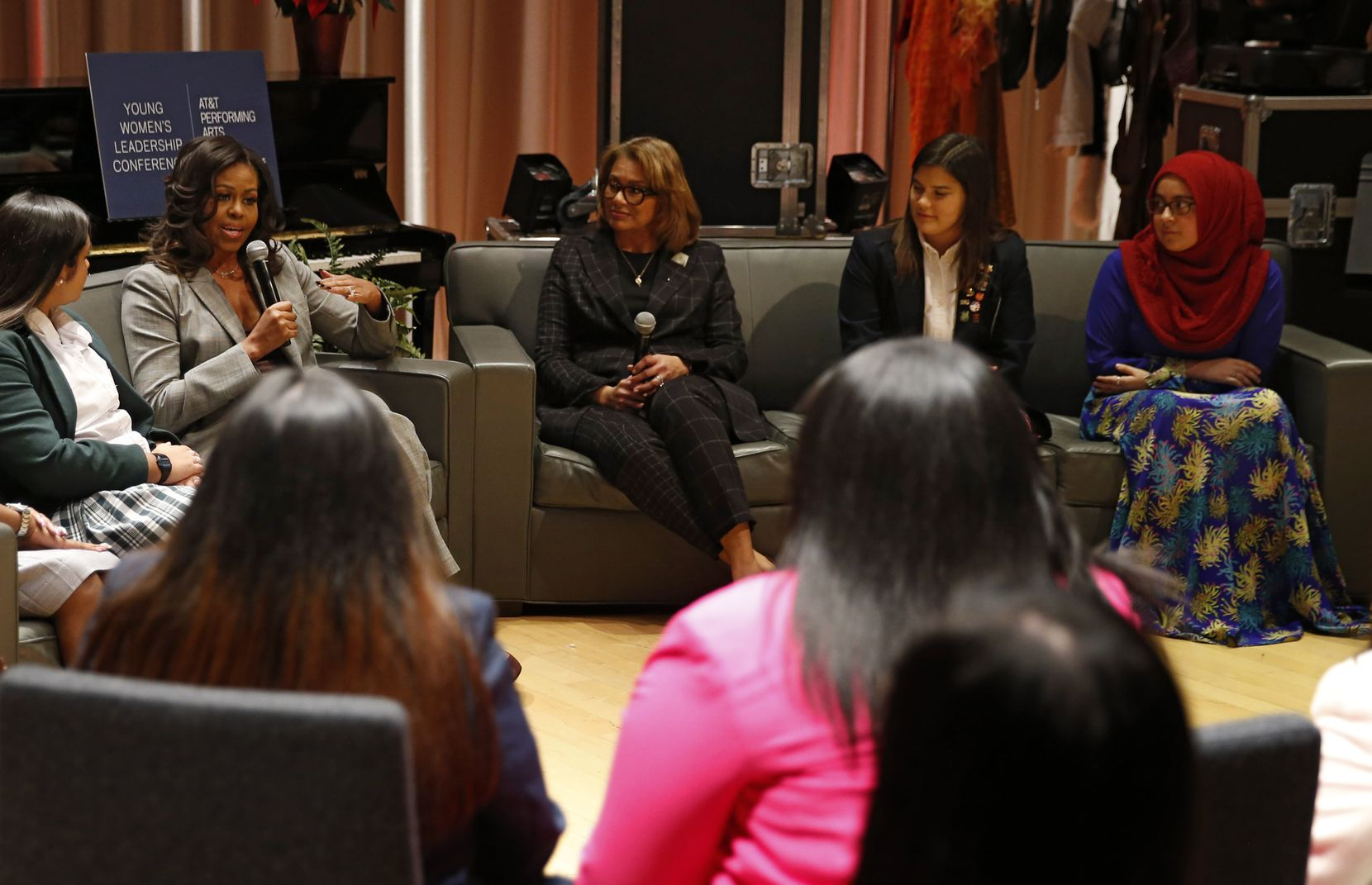 Iman Ikram (far right) of Qalam Collegiate Academy listened as former first lady Michelle Obama spoke to Dallas-area students during the first Young Women's Leadership Conference in 2018.