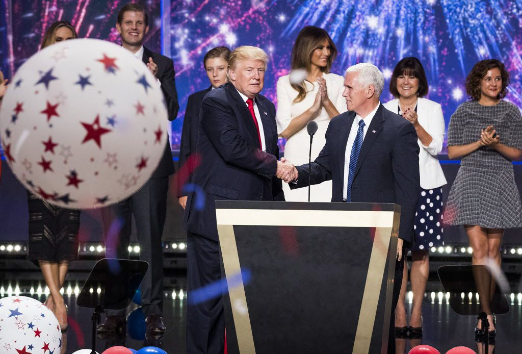 Donald Trump and Mike Pence shake hands as the Republican National Convention comes to a close in Cleveland on Thursday, July 21, 2016.