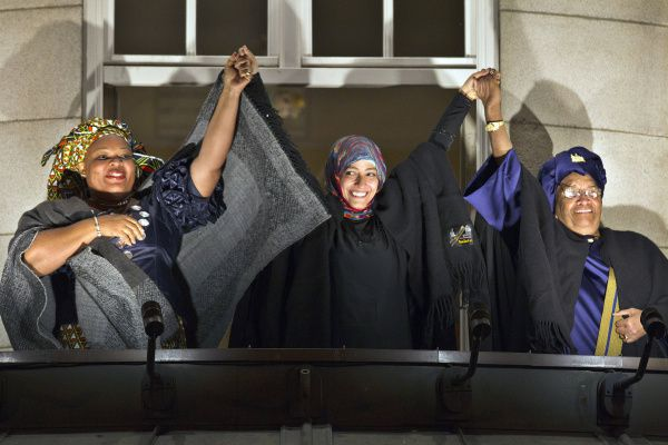 Leymah Gbowee (left) received the 2011 Nobel Peace Prize jointly with Yemeni activist Tawakul Karman (center) and Liberian President Ellen Johnson Sirleaf, Africa's first female elected leader. The three acknowledged the crowd from the balcony of Oslo's Grand Hotel after receiving their prize at a December ceremony.