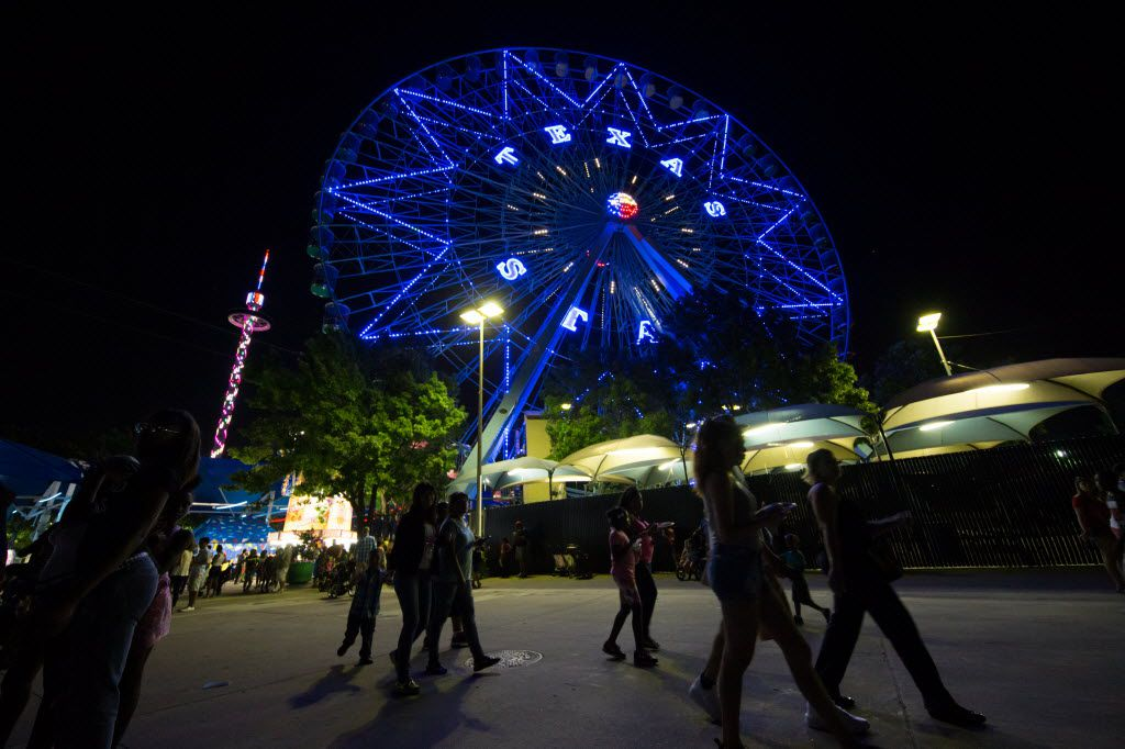 Festival goers walk pass the Texas Star Ferris wheel during the free festival celebrating the 80th anniversary of the Texas Centennial Exposition at Fair Park on June 10, 2016 in Dallas. (File Photo/Staff)