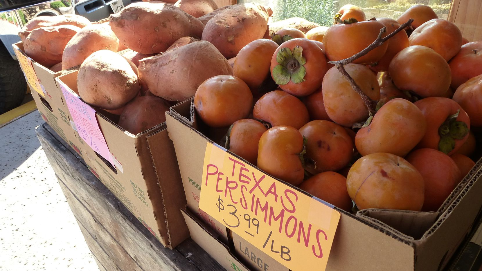 The persimmons and sweet potatoes at the Grapevine Farmers market are from East Texas farms.