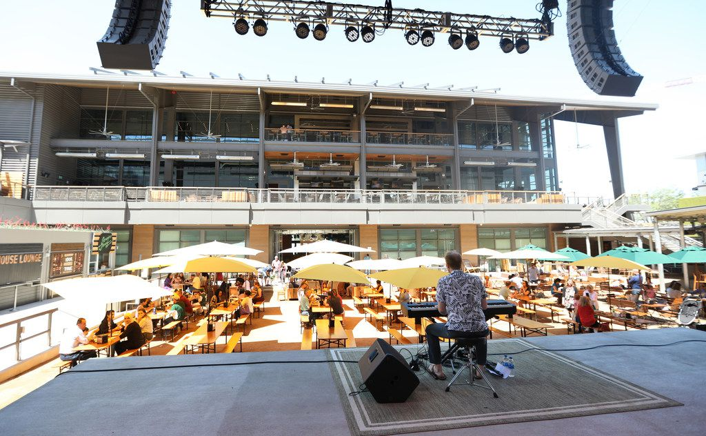The view from the stage as Ross Redmond performs at the Box Garden at Legacy Hall, part of Legacy West in Plano, Texas, Sunday, May 6, 2018.