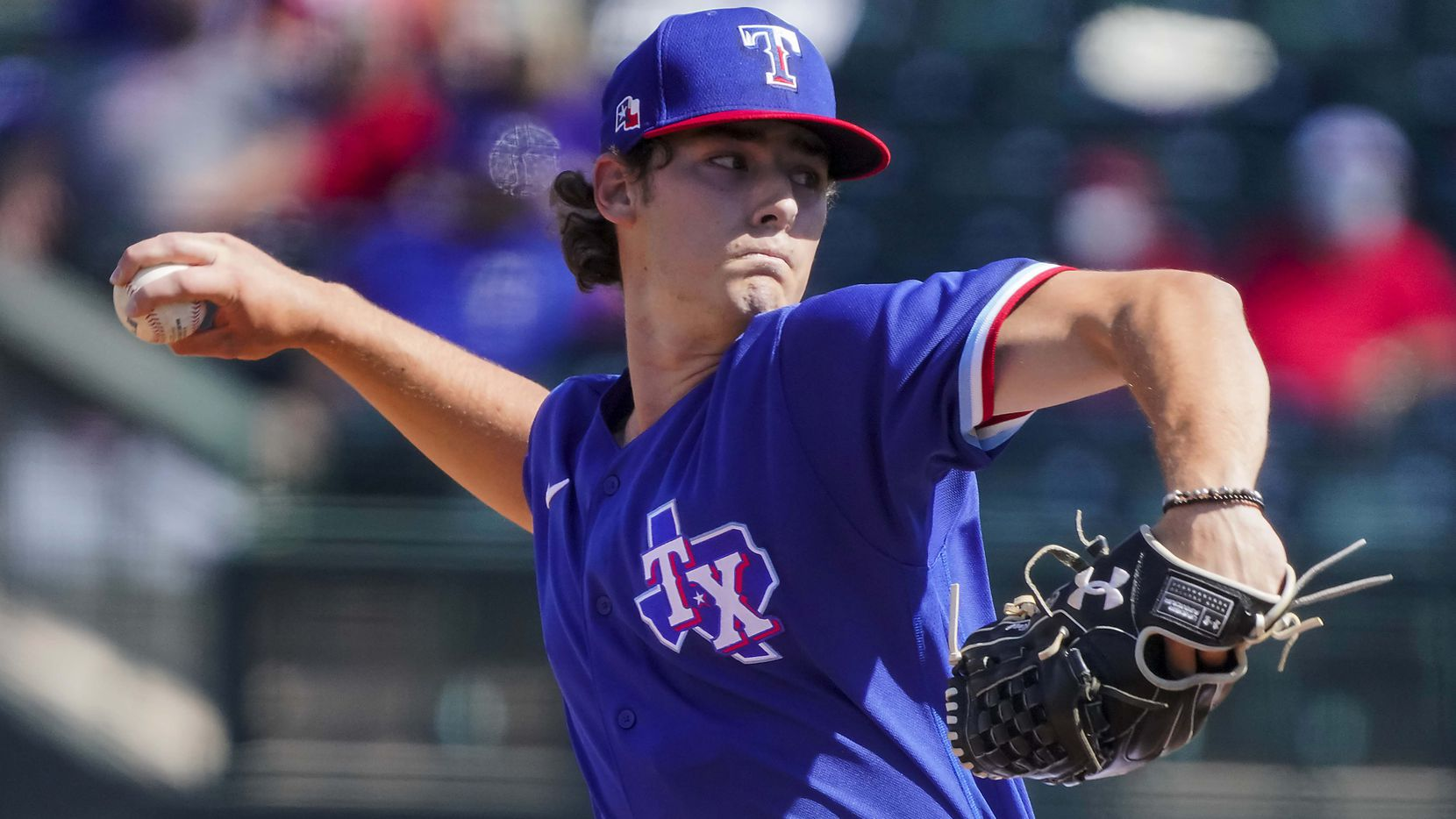 Texas Rangers pitcher Cole Winn delivers during the fifth inning of a spring training game against the Cleveland Indians at Surprise Stadium on Tuesday, March 9, 2021, in Surprise, Ariz. (Smiley N. Pool/The Dallas Morning News)