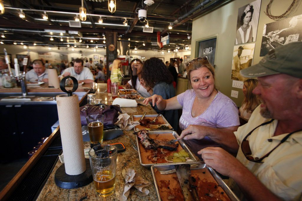 Patti Byrd and Kevin Watterud have lunch at the bar area inside the Pecan Lodge restaurant in Deep Ellum, on Wednesday, Sept. 24, 2014 in Dallas. Ben Torres/Special Contributor 09182015xPUB