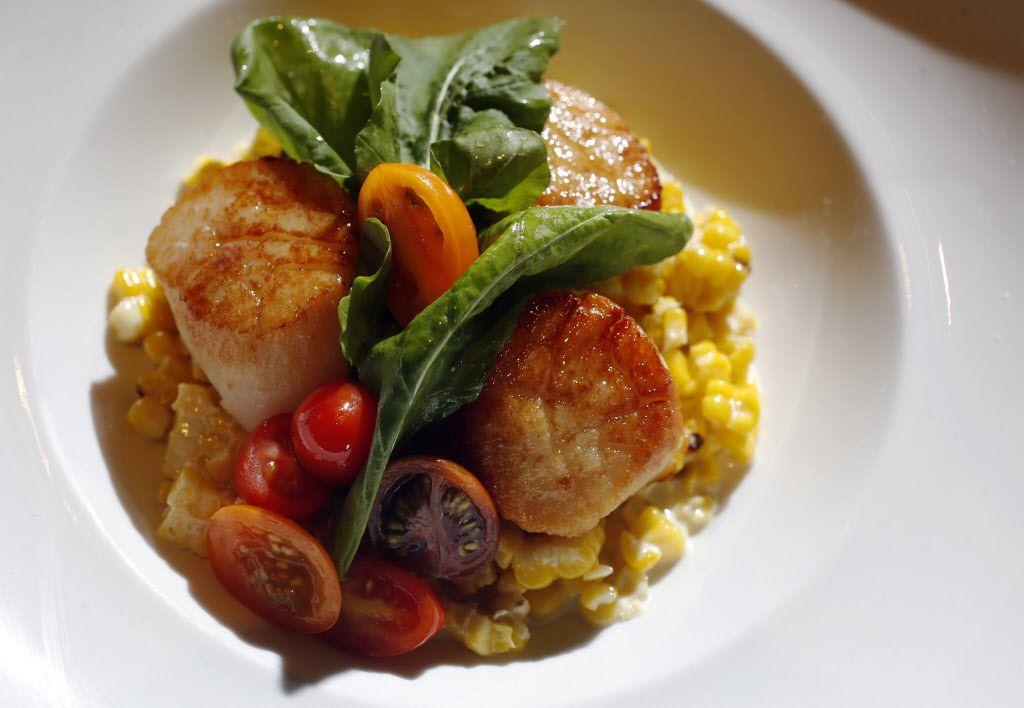 Caramelized sea scallops with creamed corn and heirloom tomato-arugula salad