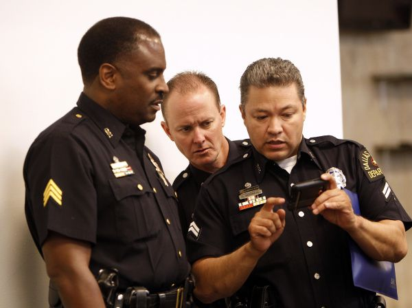 Dallas police check their phone. Criminals are using their online and phone skills to fool Americans into coronavirus-related scams. Take The Watchdog's quick quiz to see how vulnerable you are.