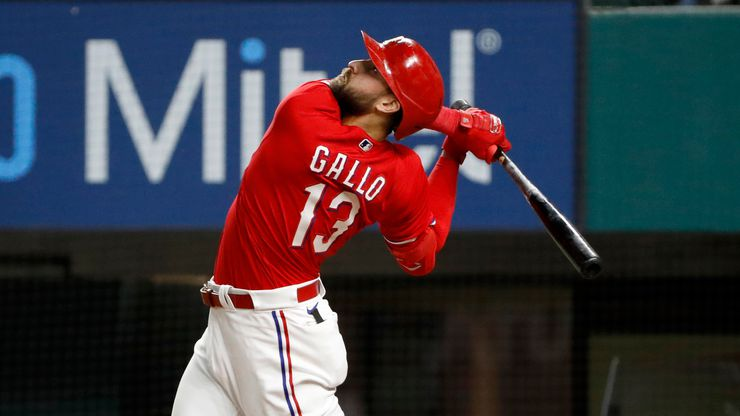 Texas Rangers Joey Gallo watches a fly ball during the ninth inning of a baseball game against the Baltimore Orioles in Arlington, Texas, Friday, April 16, 2021. Texas lost the game 5-2.