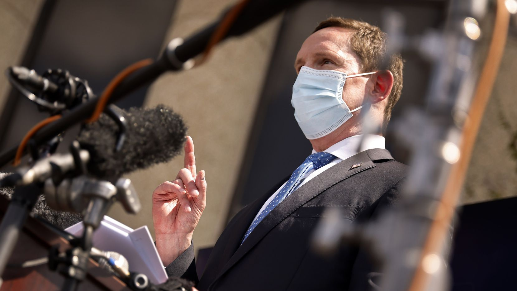 Dallas County Judge Clay Jenkins addressed the media about the current state of the delta coronavirus variant outside the Dallas County Health and Human Services building in Dallas on Aug. 10, 2021. He also spoke about the differences between he and Texas Gov. Greg Abbott when it comes to a mask mandate. (Tom Fox/The Dallas Morning News)