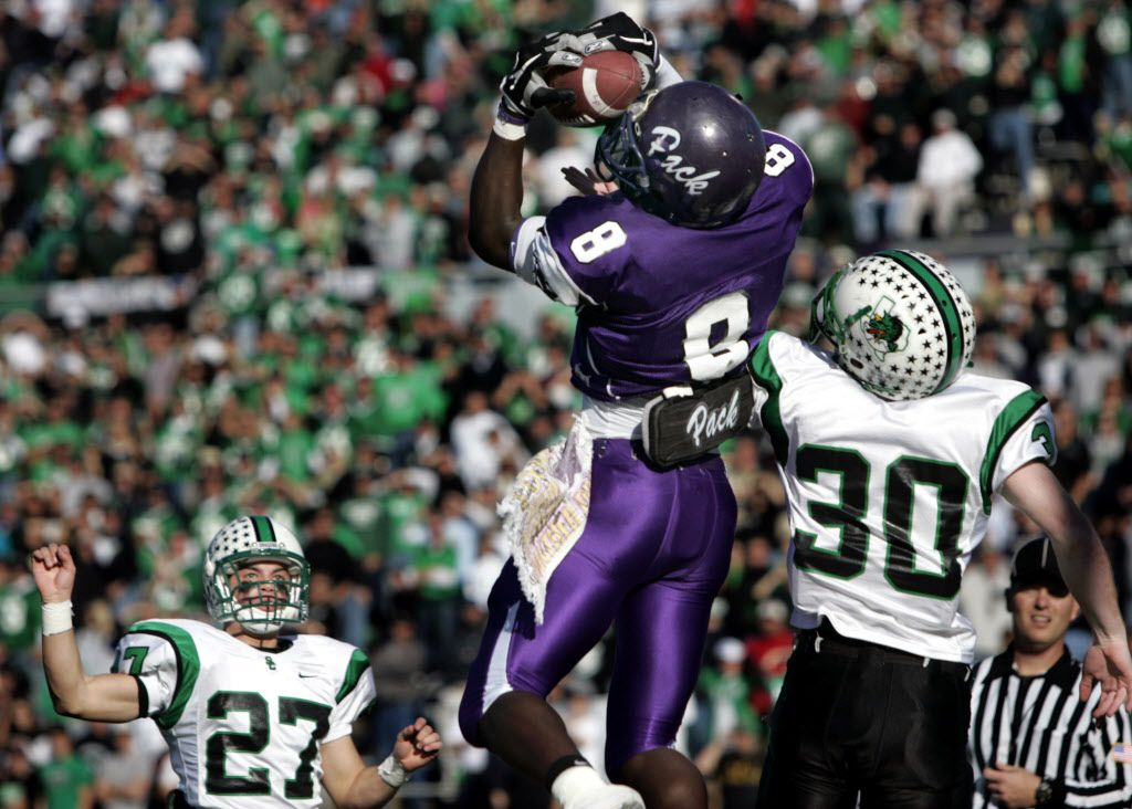 Lufkin's Dez Bryant (8) catches a pass in the in-zone scoring the Panther second touchdown during the first quarter of 5A High School football playoffs against Southlake Carroll Saturday afternoon, December 10, 2005, at Homer Bryce Stadium in Nacogdoches, Texas.