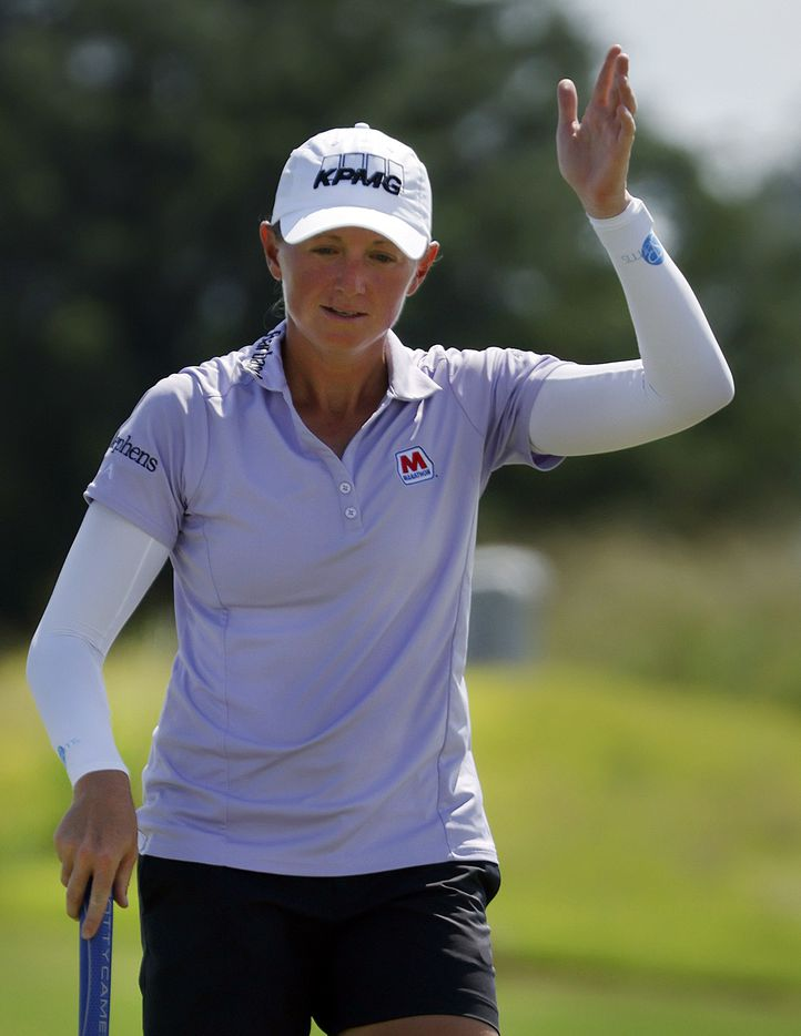 Professional golfer Stacy Lewis of The Woodlands, Texas waves after sinking a long birdie on No. 18 during the opening round of the LPGA VOA Classic at the Old American Golf Club in The Colony, Texas, Thursday, July 1, 2021. (Tom Fox/The Dallas Morning News)