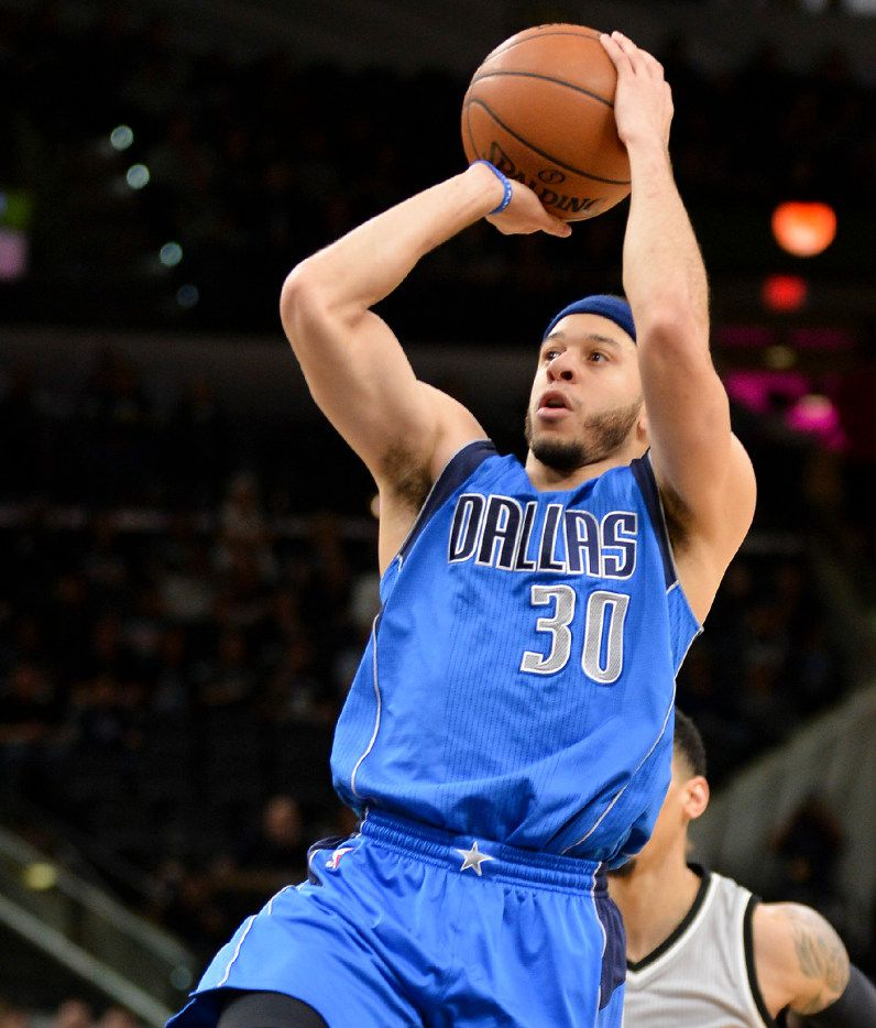 Dallas Mavericks guard Seth Curry shoots during the first half of an NBA basketball game against the San Antonio Spurs, Sunday, Jan. 29, 2017, in San Antonio. (AP Photo/Darren Abate)