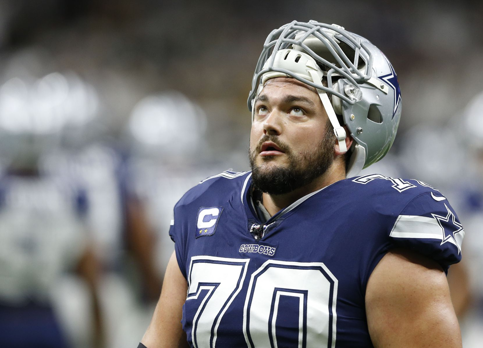 Dallas Cowboys offensive guard Zack Martin (70) looks up as he exits the field after warmups before a game against the New Orleans Saints at the Superdome in New Orleans, Louisiana on Sunday, September 29, 2019.